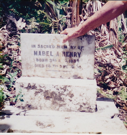 Ena Henry Williams holds the headstone of her Mother Mabel in the backyard of her house in Kellits, Jamaica
